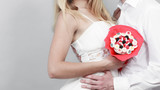 Closeup of couple with candy bunch flowers. Love. - 183266246