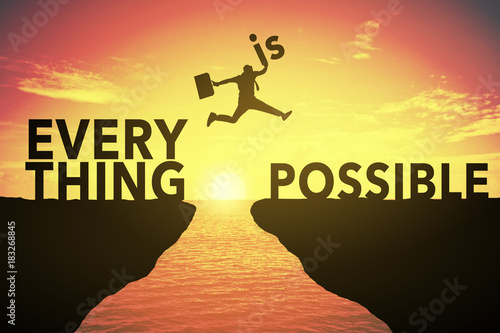 Plexiglas Zwavel geel Silhouette of young man jump between EVERYTHING IS POSSIBLE. keep go on to success concept at 2018 over a beautiful sunset or sunrise at sea. success in 2018 years. GO TO SUCCESS IN 2018 YEAR CONCEPT