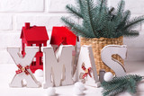 Word Xmas made from wooden letters and holiday decorations - 183270839