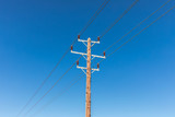 power lines on blue sky background - 183272218
