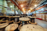 Warehouse of coils with ropes. Abstract industrial background, motion blur effect. - 183283039