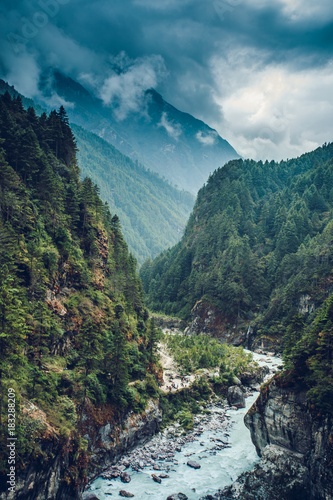 Fotobehang Bergrivier Himalayan landscape with mountains, forest and a mountain river on trek on Everest base camp