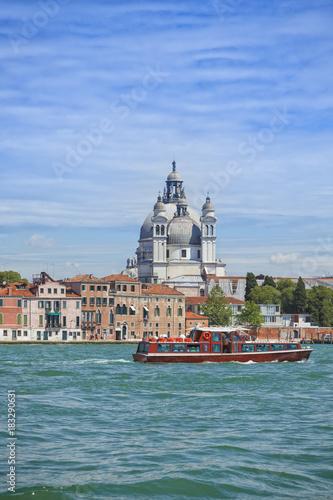 Foto op Canvas Venetie Venice, Basilica Santa Maria della Salute and tourist boat