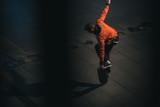 skateboarder balancing with board