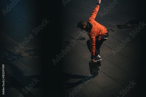 Fototapeta skateboarder balancing with board