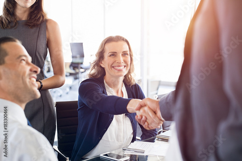 Sticker Mature businesswoman shaking hands