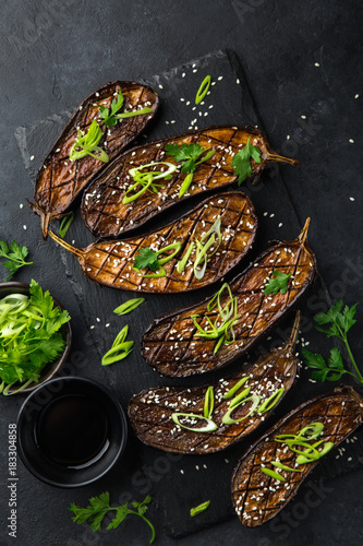 Foto op Canvas Natuur glazed grilled eggplants served with sesame seeds and green onion
