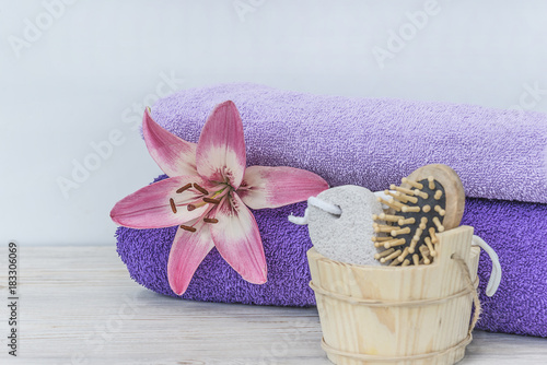 Foto op Canvas Zen pink lily and spa tools and towls