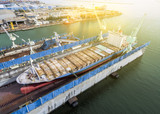 aerial view shipyard have crane machine and container ship in green sea . - 183306889