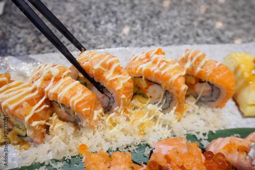 Plexiglas Sushi bar Sushi sashimi and sushi rolls set