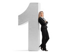 Formally dressed woman leaning against a cardboard number one - 183312474