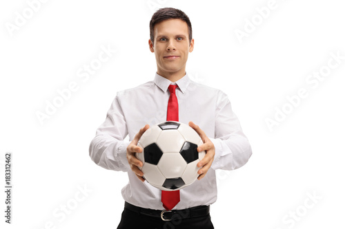 Fotobehang Voetbal Formally dressed guy giving a football