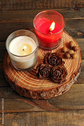 Two candles lit on wood © Nacho