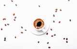 Small cup of black espresso coffee with foam, white background, top view - 183316010