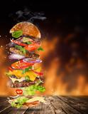 Big tasty burger with flying ingredients. - 183327008