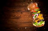 Big tasty burger with flying ingredients. - 183327041
