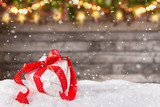 Christmas gift on wooden background - 183327419
