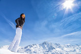 Beautiful brunette woman with ski - 183327699