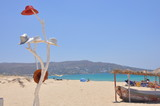 White decorative tree with hats in Naxos beach picture, Greece - 183329898