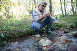 Biologist testing water quality of river - 183331810