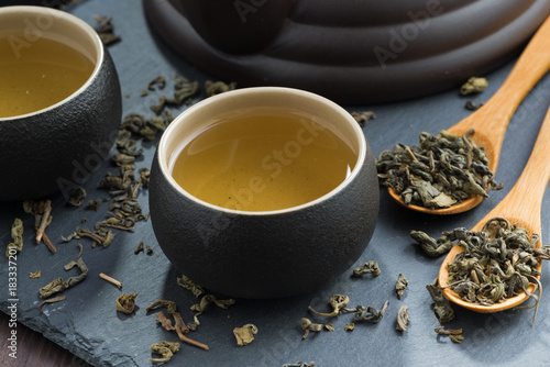 Sticker pialas with green tea on a dark background, close-up
