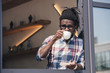 african american man drinking coffee in cafe