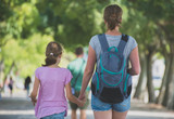 Mother and daughter walking in the city. Back view. - 183348043