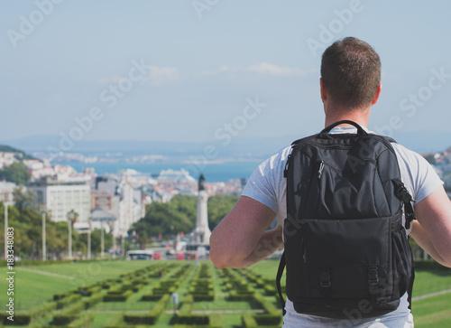 Man tourist in Eduardo VII Park in Lisbon.