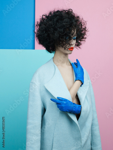 Tuinposter womenART Fashion portrait of beautiful asian woman in sky-blue coat