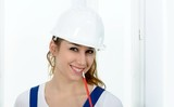 Young engineer woman with white safety hard hat - 183357205