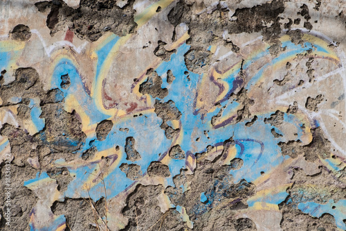 old wall background - peeling off plaster and paint remains Poster