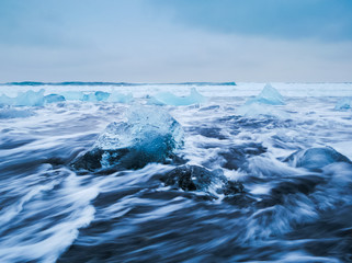 .Icebergs floating on black volcanic beach, South Iceland