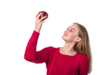 Pretty blonde girl with red apple in her hand, white background - 183368810
