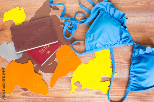 Travel concept, traveler`s accessories on the wooden background.