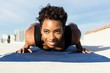 Young attractive woman working out on rooftop