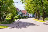 beautiful street with modern residential houses in summer sunny - 183374236