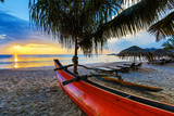 Sun loungers with umbrella on the beach, sunset - 183374253