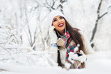 Attractive young woman in wintertime outdoor - 183376412