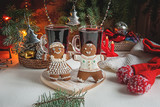 Christmas gingerbread and two glasses of mulled wine for the Christmas table on a background of garlands and Christmas twigs - 183378874
