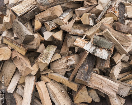 Tuinposter Brandhout textuur horizontal picture of firewood ready to burn in closeup