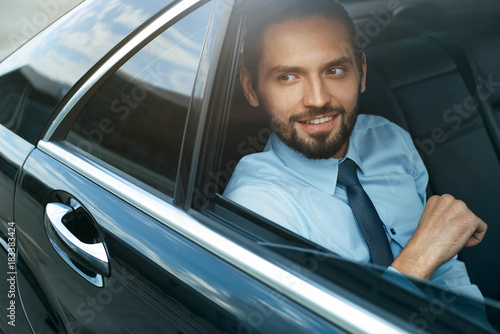 Business Man Going To Work In Car