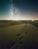 Starry Night Lone Figure on Sand Dunes with Milky Way