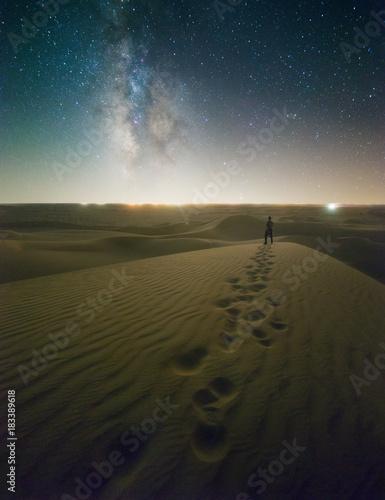 Plexiglas Strand Starry Night Lone Figure on Sand Dunes with Milky Way