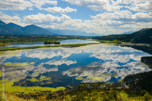 Plexiglas Bleke violet Reflection Wetlands Mountain Landscape