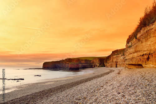 Impressive red sandstones of the Ladram bay on the Jurassic coast, a World Herit Poster