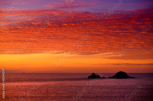 Foto op Canvas Baksteen Sunset over Porth Nanven in the Cot Valley of Cornwall, England