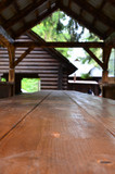 Interior of a wooden arbor handmade from dark wood in the woodland - 183405097