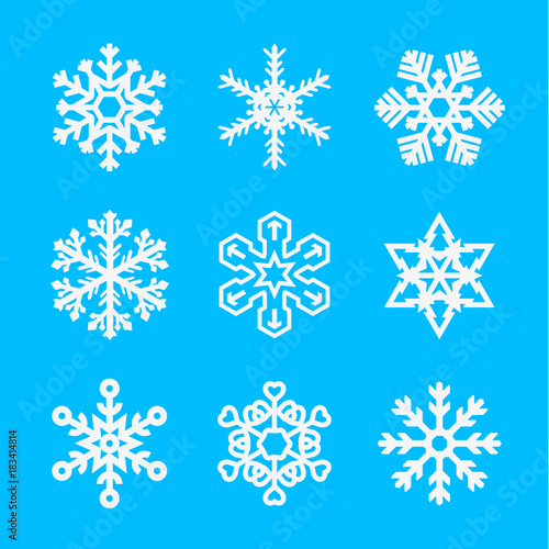 Several Different Types of Snowflakes. Snowflakes of Different Shapes on a Blue Background. Vector Illustration - 183414814