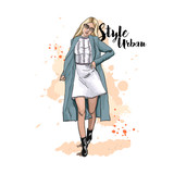 Urban style. Fashionable bow. Clothing for the street. Hand drawn sketch. Stylish young woman in dress and coat. Vector illustration. - 183422258