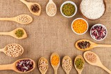 Assorted grain, beans, legumes, peas, lentils in spoons on a - 183426426